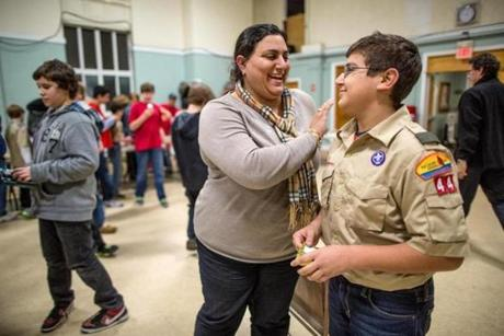 Nicole Jdey with son George, 11, at a holiday party for Boy Scout Troop 44 at Blackburn Hall in Walpole.